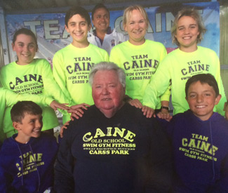 Coach Dick Cainewith his squad of future champions in their Team Caine outfits