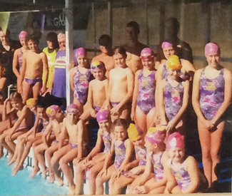 Coach Dick Caine with all his squad wearing their Representative Team Caine swimsuits