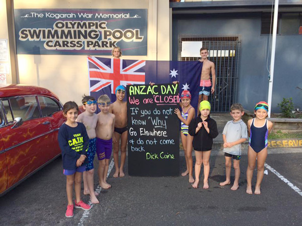 Team Caine at front of Pool with ANZAC DAY sign